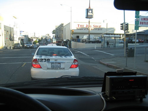 A Luxor Cab stopped at anintersection