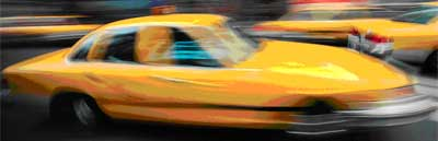 yellow taxi with motion blur cropped