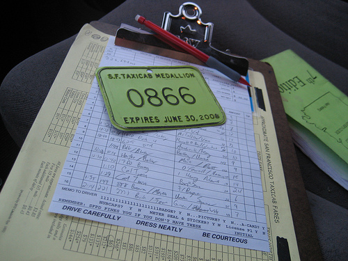 San Francisco taxi waybill and medallion on a clipboard