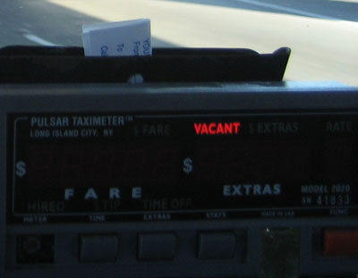 A San Francisco taximeter with the words 'VACANT' lit by a red LED