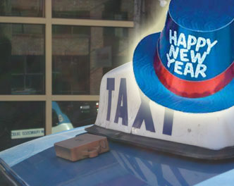happy new year hat superimposed over a taxi top light